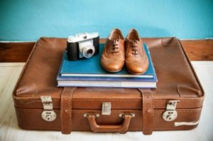 vintage-still-life-with-suitcase-and-shoes
